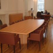 barrel boardroom table in light veneer