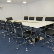 white boardroom table contrast cable covers